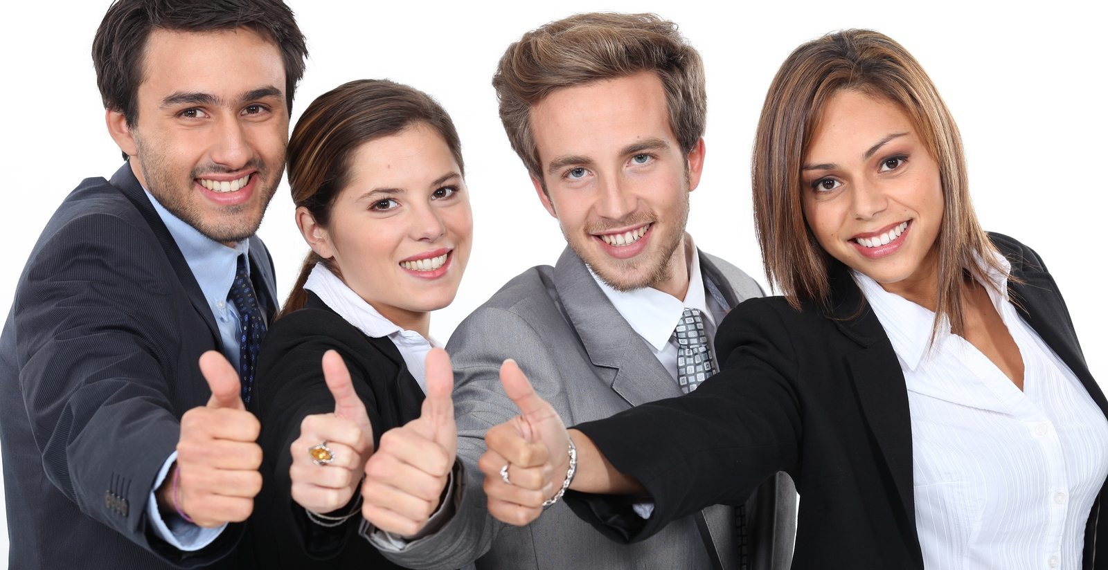Four young professionals giving the thumbs up